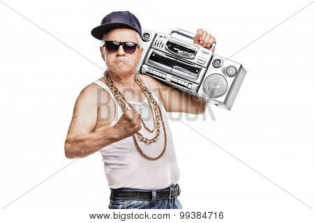 Mature man in hip-hop outfit holding a ghetto blaster and looking at the camera isolated on white background poster