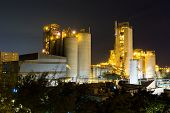 coal power station and cement plant at night poster