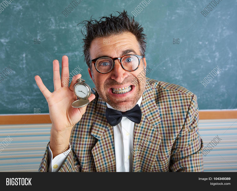 2cdd8cbed379 Nerd silly teacher showing vintage chain watch in green blackboard