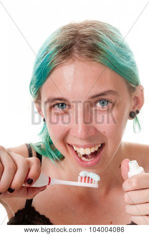 Close-up of a young woman needing dental care about to brush teeth