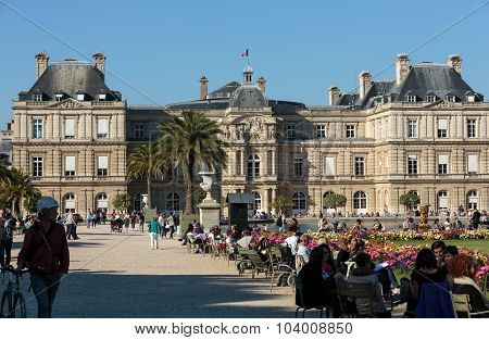 PARIS FRANCE - SEPTEMBER 12 2014: People relax in Luxembourg Gardens in Paris France. Luxembourg area is popular among tourists in Paris the most visited city worldwide.