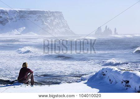 Woman Enjoys View O Three Pinnacles Of Vik, Iceland