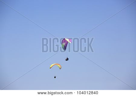 Colorful Paragliders With Blue Sky