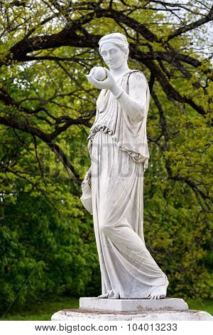 Marble statue of the Greek goddess Hera or the Roman goddess Juno holding an apple of discord in the park of the Palace and park complex Estate of G. Galagan. Sokyryntsi village Ukraine