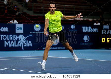KUALA LUMPUR, MALAYSIA - SEPTEMBER 30, 2015: Ivo Karlovic of Croatia hits a backhand return in his match at the Malaysian Open 2015 Tennis tournament held at the Putra Stadium, Malaysia.