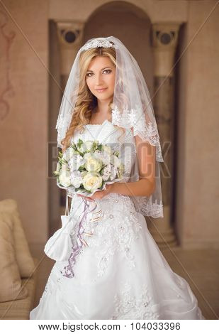 Beautiful Smiling Bride Woman With Bouquet Of Flowers, Wedding Makeup Hairstyle, Bridal Veil. Girl W
