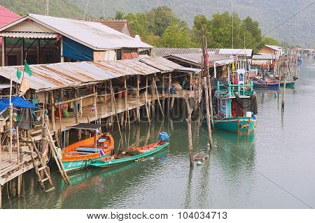 View to the boats tied at the fishermen village in Sam Roi Yot National park, Sam Roi Yot, Thailand.