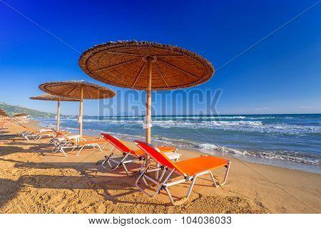 LAGANAS, GREECE - AUG 23, 2015: Umbrellas and sundecks of the sandy Banana Beach on Zakynthos, Greece. Banana is the largest beach of Zakynthos island.