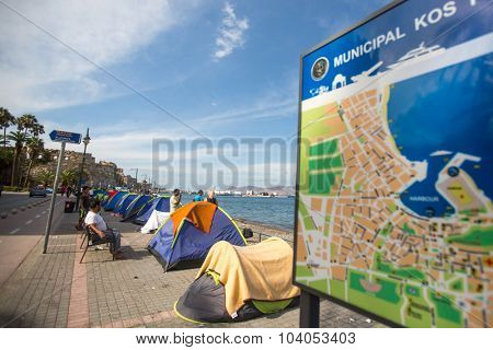 KOS, GREECE - SEP 27, 2015: Tents war refugees in the port of Kos island. Kos island is located just 4 kilometers from the Turkish coast, and many refugees come from Turkey in an inflatable boats.