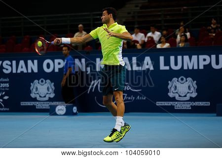 KUALA LUMPUR, MALAYSIA - OCTOBER 01, 2015:Grigor Dimitrov of Bulgaria hits a forehand return in his match at the Malaysian Open 2015 Tennis tournament held at the Putra Stadium, Malaysia.