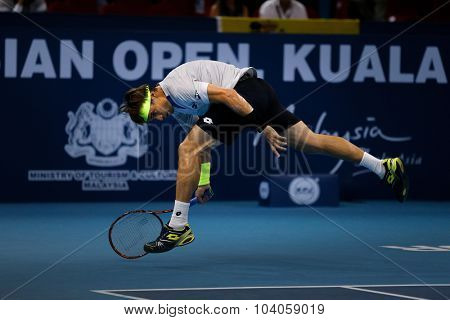 KUALA LUMPUR, MALAYSIA - OCTOBER 01, 2015: David Ferrer of Spain attempts a hit a return in his match at the Malaysian Open 2015 Tennis tournament held at the Putra Stadium, Malaysia.