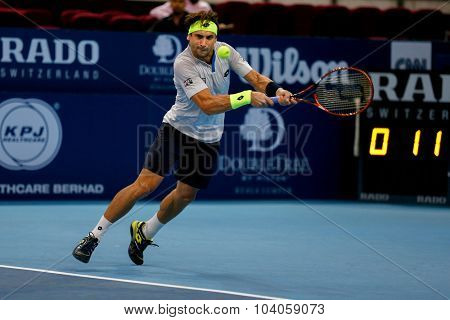 KUALA LUMPUR, MALAYSIA - OCTOBER 01, 2015: David Ferrer of Spain plays a backhand return in his match at the Malaysian Open 2015 Tennis tournament held at the Putra Stadium, Malaysia.