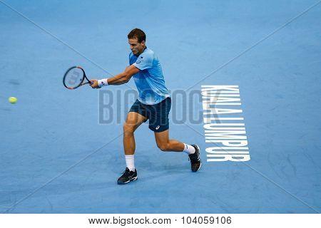 KUALA LUMPUR, MALAYSIA - OCTOBER 01, 2015: Vasek Pospisil of Canada plays a forehand return during his match at the Malaysian Open 2015 Tennis tournament held at the Putra Stadium, Malaysia.