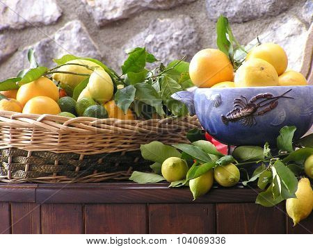 Citrus Fruit In Basket And Blue Bowl In Cefalu