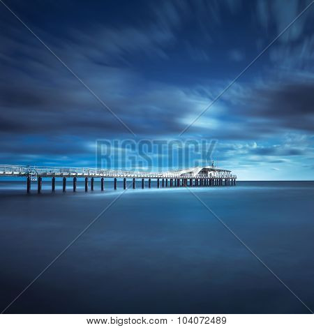 Modern steel pier in a cold atmosphere Long exposure photography in Lido Camaiore Versilia Tuscany Italy Europe poster