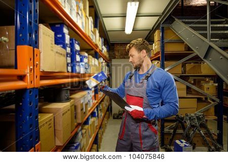 Worker on a automotive spare parts warehouse  poster