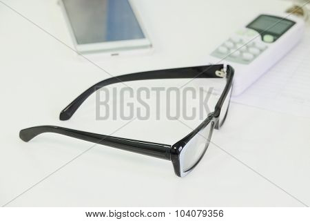 The image of a glasses on a table