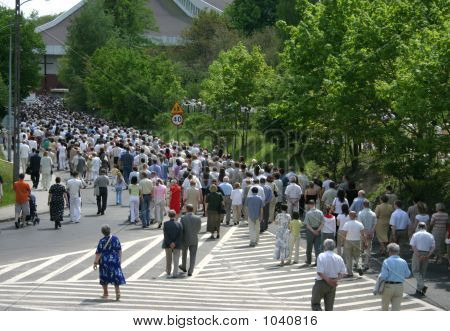 a crowd of people walking on the street poster