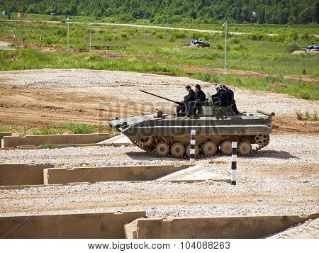 Command of military firefighters on BMP-2 on the obstacle