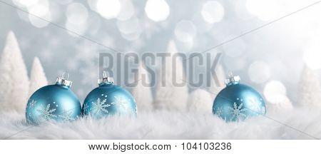 Christmas balls and fir tree on snow