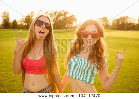 Two Sexy Funny Girls With Red Glasses Fooling Around