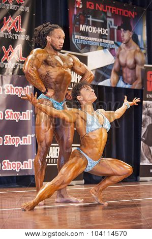Bodybuilding Duoshowing Their Puscular Body On Stage