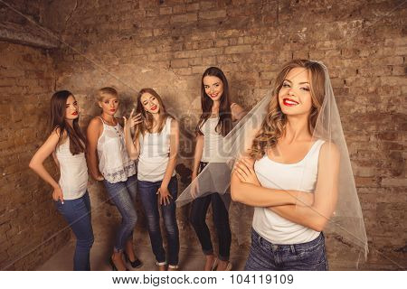 Beautiful Bride Standing In Front Of Her Bridesmaids Celebrating Hen-party