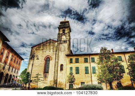 Sant'Antonio abate steeple in Pisa under clouds poster