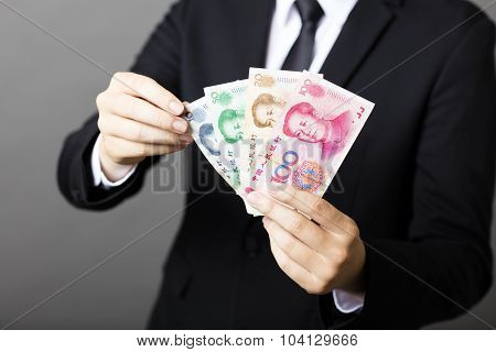 Businessman Holding Yuan Rmb In His Hands