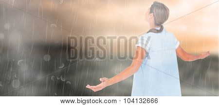 Woman with arms outstretched over white background against stormy sea with lighthouse