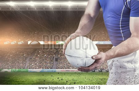 Rugby player about to throw the rugby ball against rugby fans in arena