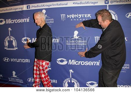 MOORPARK, CA - OCT 5: Robbie Krieger and Scotty Medlock arrive at the 8th Annual Medlock/Krieger Invitational Golf Concert at the Moorepark Country Club in Moorpark, CA on October 5, 2015.