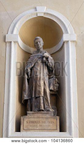 LJUBLJANA, SLOVENIA - JUNE 30: Saint Thomas Aquinas on the facade of St Nicholas Cathedral in the capital city of Ljubljana, Slovenia on June 30, 2015