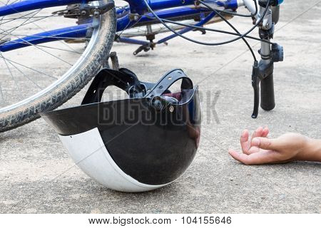 Bicycle And A Helmet Lying On The Road With Hand Of Human, Accident Concept.