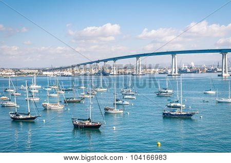 San Diego Waterfront With Sailing Boats - Indutrial Harbor And Coronado Bridge
