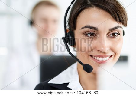 Female Call Center Service Operator At Work