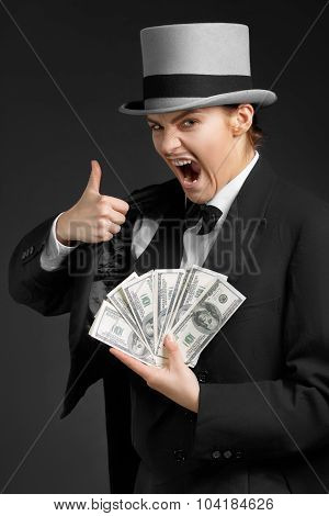 Gangster girl keeps money in hands and showing OK sign poster