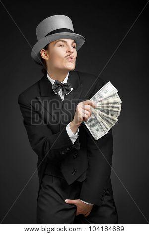 Gangster girl keeps money in hands over dark background poster