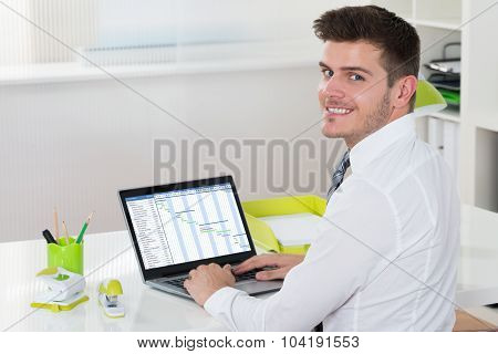 Businessman Working With Gantt Chart On Laptop