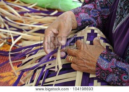 Traditional food cover woven from pandanus leaves