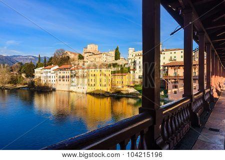 The Ponte Vecchio (or Ponte degli Alpini) bridge and colorful houses on the Brenta river in Bassano del Grappa Veneto Italy poster