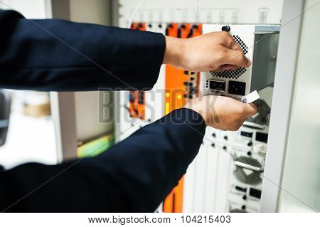 Fix network switch in data center room . poster