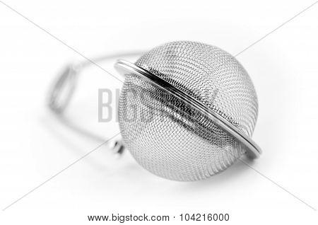 tea strainer close up on white