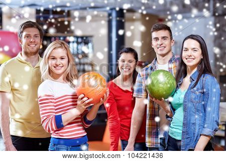 people, leisure, sport, friendship and entertainment concept - happy friends in bowling club at winter season poster