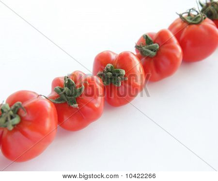 Ripe red tomatoes on white background