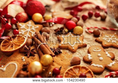 christmas baking ingredients - christmas gingerbread cookies, spices, nuts and fruits
