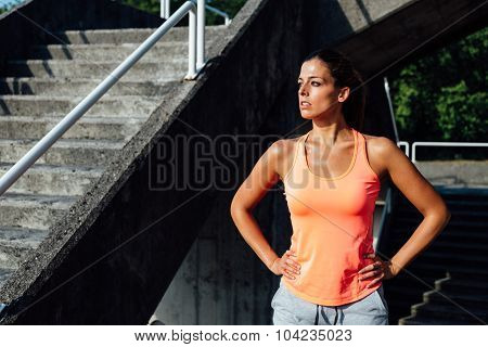 Female Motivated Athlete Sweating