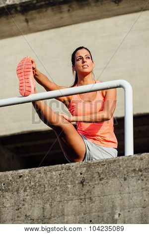 Female Athlete Stretching For Warming Up