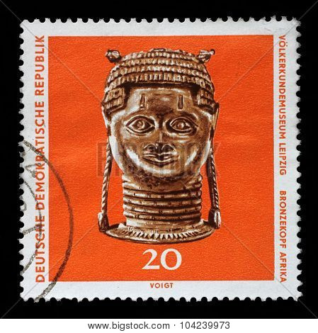 GDR-CIRCA 1971: A stamp printed in GDR shows bronze head from Africa, The Ethnography Museum of Leipzig, circa 1971.