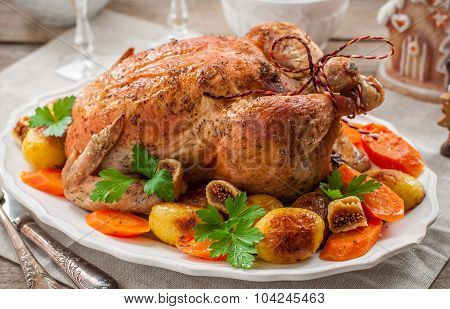 Christmas Stuffed Chicken Served With Potatoes, Carrots And Figs